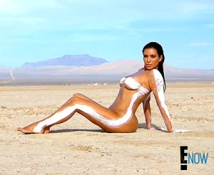 Kim Kardashian stripped down yet again for a nude photo shoot on the May 10 episode of Keeping Up With the Kardashians.  Image Credit: E! Entertainment